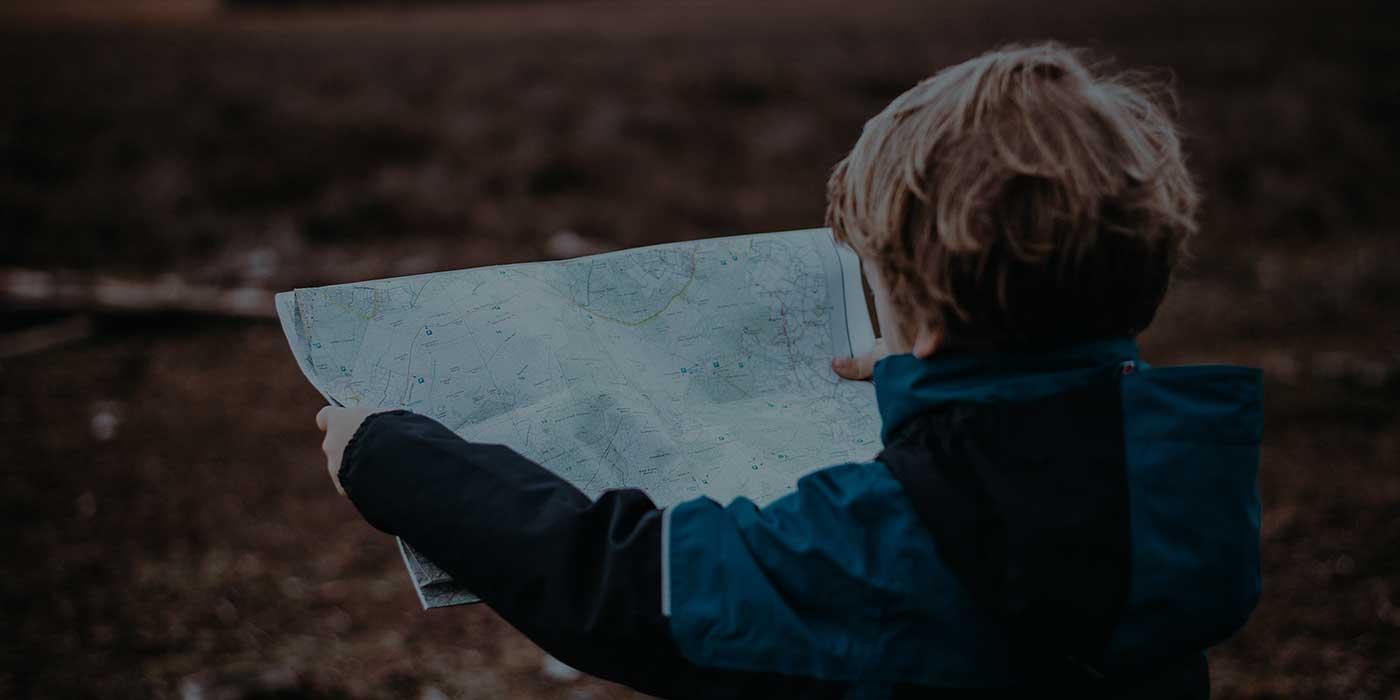 Boy holding a map