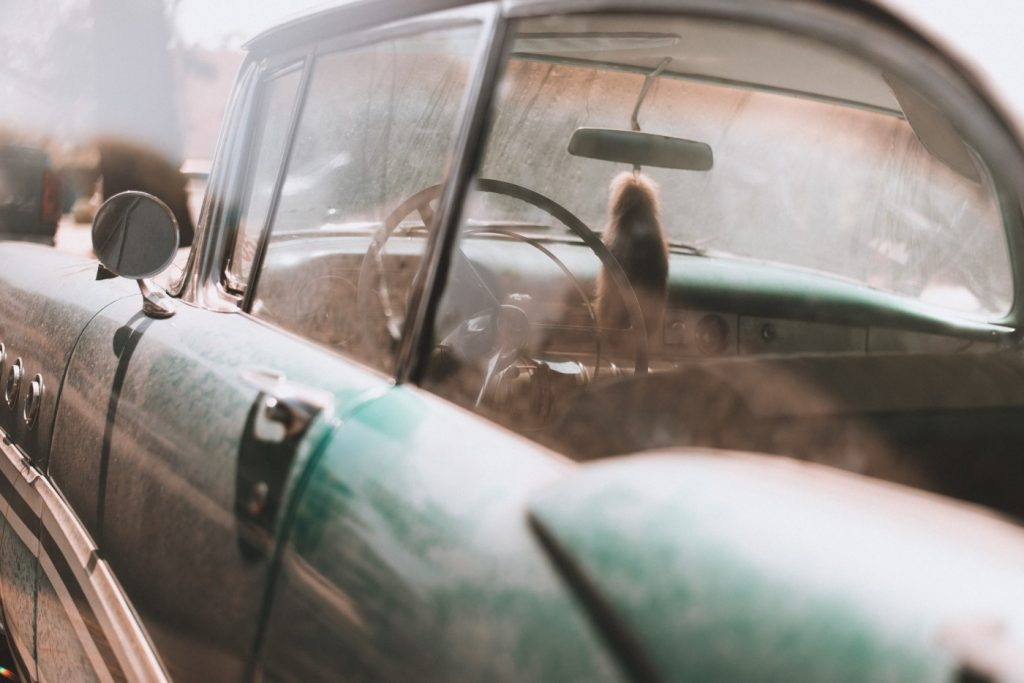 A dusty car ready to be scrapped