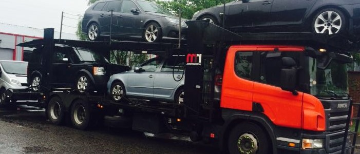 Scrap and salvage cars being collection in Reading